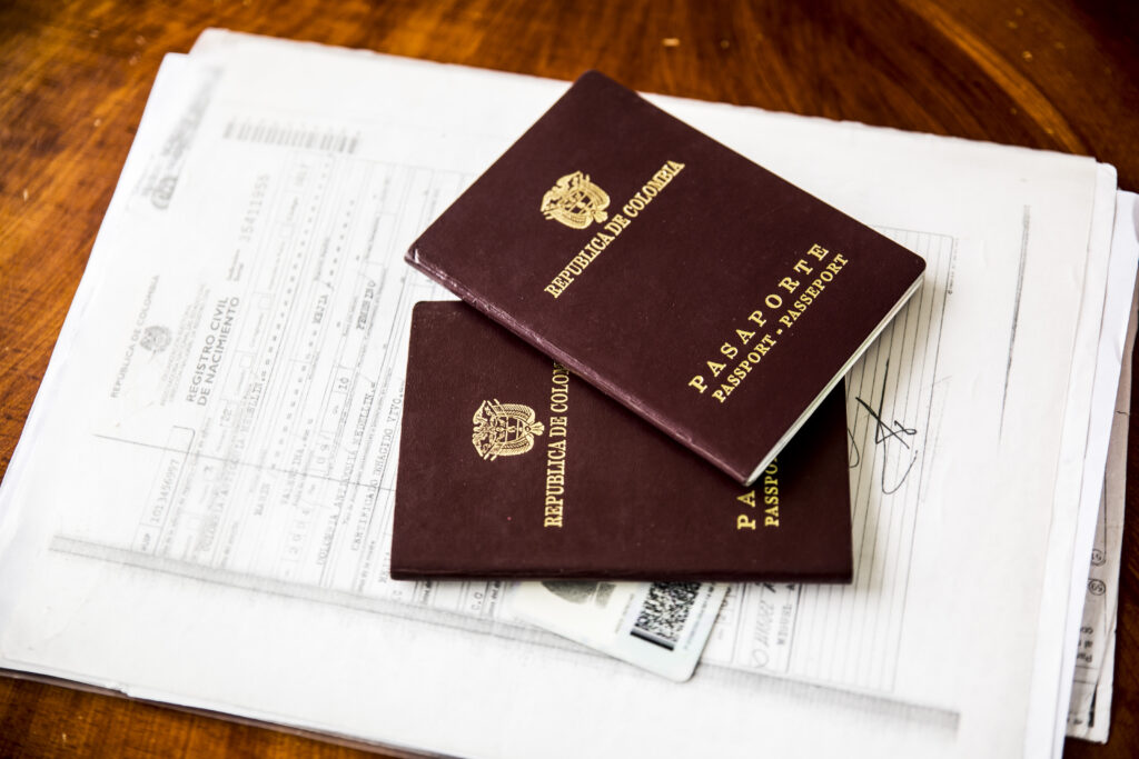 Image shows two passports on top of various legal documents